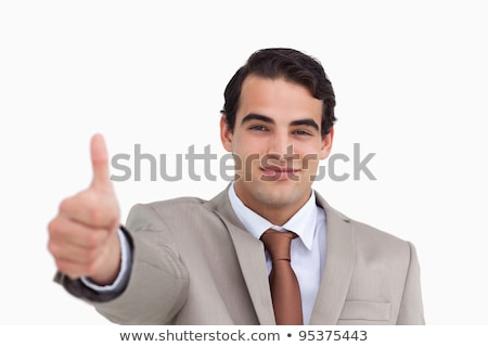 close up of young salesman giving thumb up against a white background stock photo © wavebreak_media