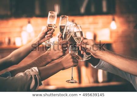 Olgun kadın cam şampanya yalıtılmış siyah Stok fotoğraf © winterling