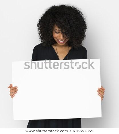 Mujer blanco cartel mirando hacia abajo mano Foto stock © wavebreak_media