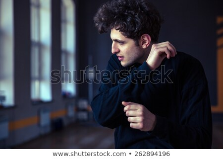 Handsome athlete with curly hair Stock photo © konradbak