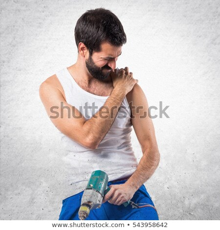 Builder with muscular pain Stock photo © photography33