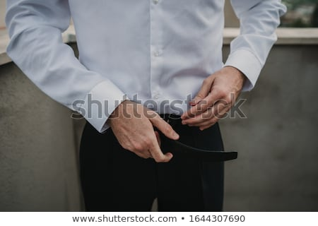 A man holding his hands on his belt stock photo © a2bb5s