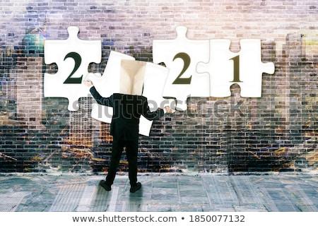 бизнесмен числа деловой человек номер телефона экране серый Сток-фото © matteobragaglio