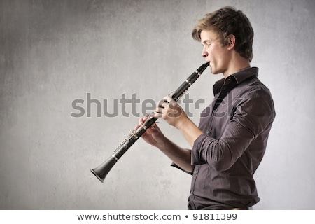 Boy playing on the clarinet Stock photo © emese73