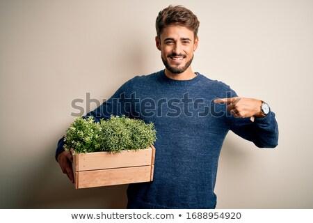 Sorridente homem planta asiático sessão Foto stock © iofoto