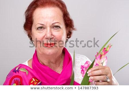 Senior flor mulher olhando determinado Foto stock © ozgur