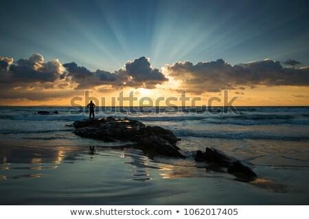rocas · surf · puesta · de · sol - foto stock © lianem