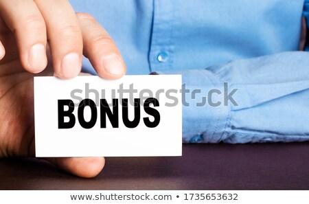 üzletember tart bónusz kártya illetmény egyéb Stock fotó © stevanovicigor