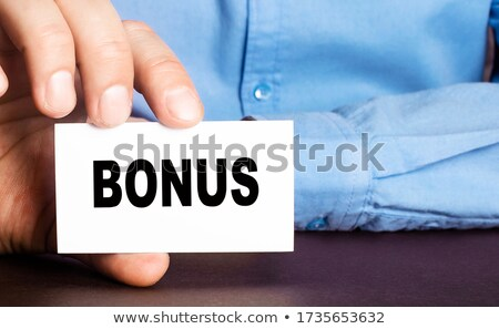 Businessman holding Bonus card. Stock photo © stevanovicigor