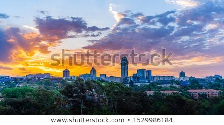 sziluett · naplemente · narancs · szeszélyes · égbolt · épület - stock fotó © bradleyvdw