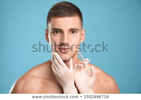 Plastic surgery. Attractive, handsome man Stock photo © racoolstudio