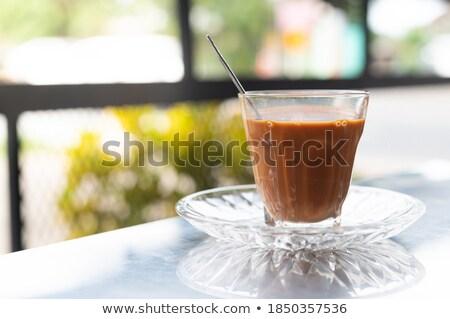 Break time with cold thai milk tea  stock photo © nalinratphi