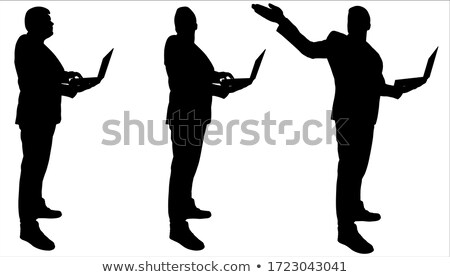 vector silhouettes of man with laptop  stock photo © Slobelix