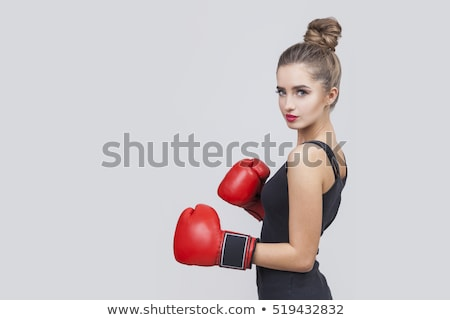 Beautiful girl defends in boxing gloves Stock photo © Aikon
