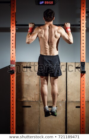 Toes to bar man pull-ups personal trainer Stock photo © lunamarina