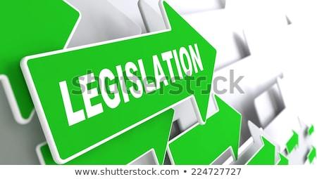 Législation vert direction signe flèche Photo stock © tashatuvango
