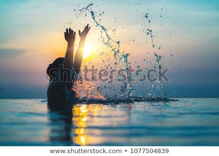 risonho · menina · ar · colchão · jovem · piscina - foto stock © dash