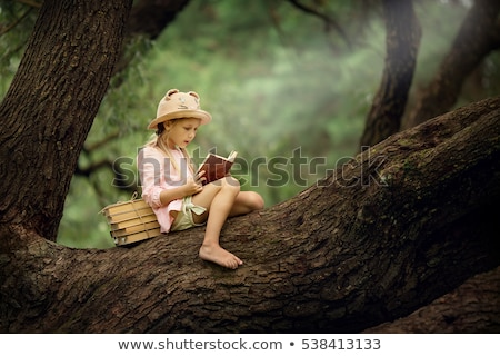 girl sitting on large tree stock photo © petrmalyshev