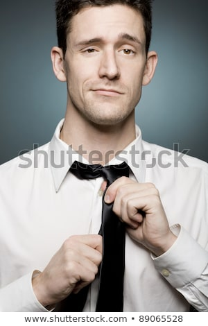 handsome fashion man fixing his collar stock photo © feedough