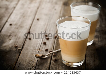 Zdjęcia stock: Latte Macchiato With Cocoa And Beans On White