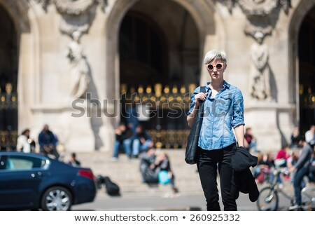 blonde woman portrait in front of opera theater paris france stock photo © sarymsakov