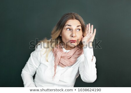 nosy surprised woman hand to ear secretly listen in on gossip Stock photo © ichiosea