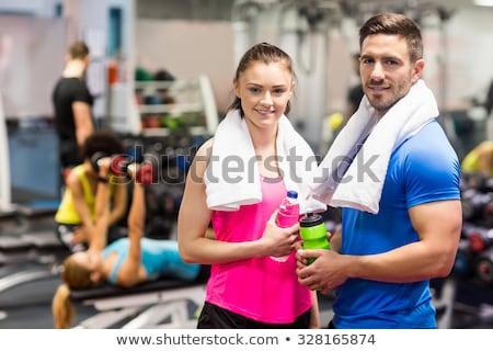 соответствовать человека женщина улыбается камеры вместе белый Сток-фото © wavebreak_media