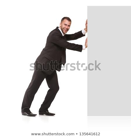 business man pushing something stock photo © fuzzbones0