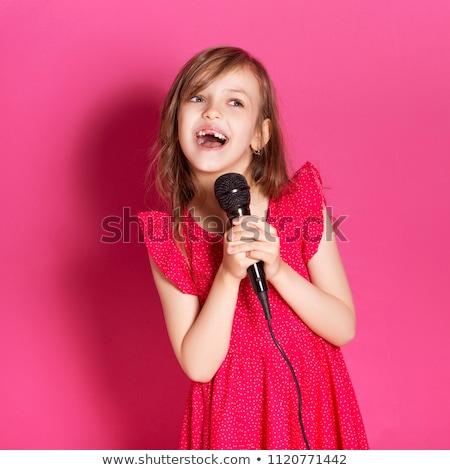 sonriendo · colegiala · mano · retrato · elemental · edad - foto stock © nyul
