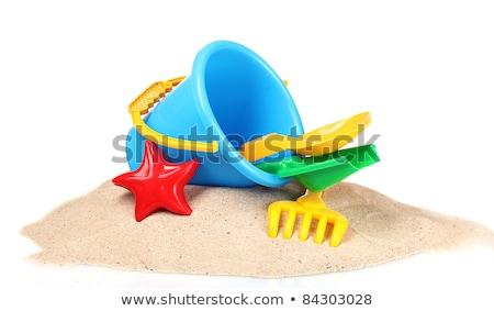 blue pail and shovel children vacation toys in beach stock photo © lunamarina