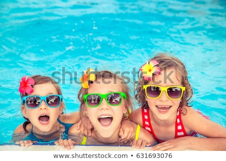 Sunglasses at the swimming pool Stock photo © filipw