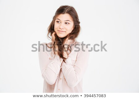 Charming young woman touching her hair and looking away  Stock photo © deandrobot
