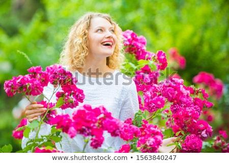 Happy woman walking in blooming garden Stock photo © deandrobot
