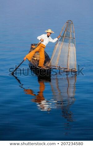 fisherman with net at inle lake stock photo © mikko