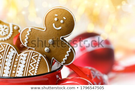 chocolate christmas gingerbread heart shape decorated with white stock photo © djmilic