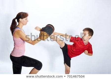 woman practicing martial arts Stock photo © Giulio_Fornasar
