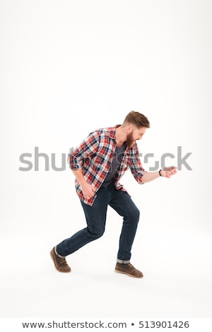 Casual bearded man in plaid shirt playing air guitar Stock photo © deandrobot