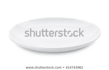 Square white porcelain plate Stock photo © Digifoodstock