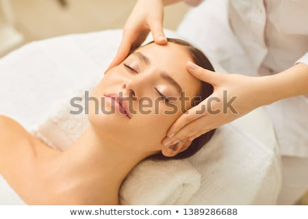 Facial massage. Pretty woman relaxing in the beauty treatment.  Сток-фото © Yatsenko