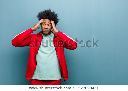 thoughtful young african sportsman posing stock photo © deandrobot