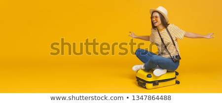 woman with suitcase and ticket at the airport stock photo © rastudio