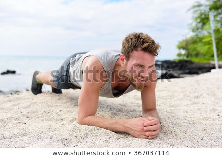 Man exercising on sand at beach Stock photo © wavebreak_media