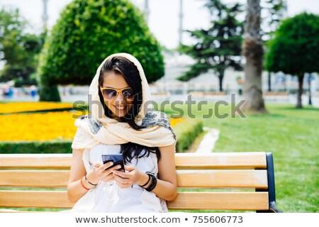 Happy asian malay teen lady with sunglasses outdoors stock photo © palangsi