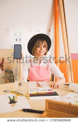 Derűs fiatal kaukázusi hölgy festő munkaterület Stock fotó © deandrobot