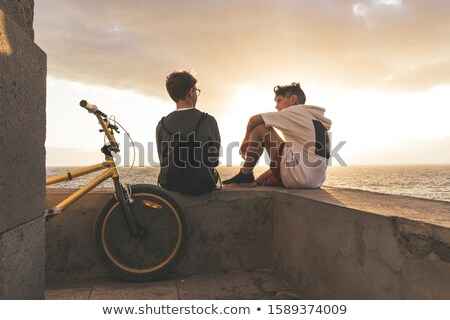 Teen boy sitting on bike Stock photo © IS2