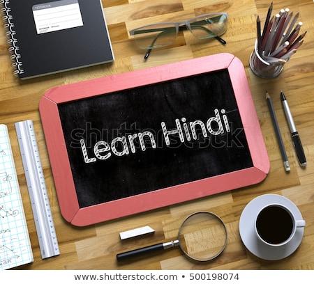 Learn Hindi Concept on Small Chalkboard. 3D. Stock photo © tashatuvango
