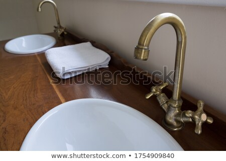 Sinks with steel taps installed on marble platform Stock photo © wavebreak_media