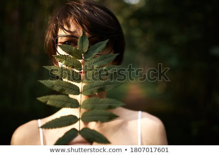 young girl hiding face with hands stock photo © is2