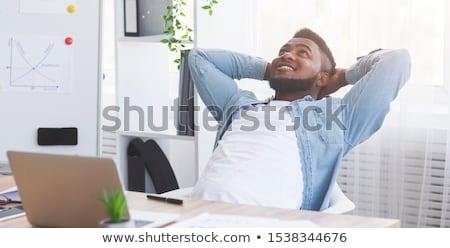 Foto stock: Homem · inclinando-se · para · trás · cadeira · sorridente · negócio · escritório