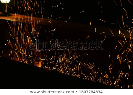 Abstract industrial sparks background with motion blur and bokeh Stock photo © tuulijumala